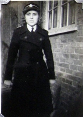 Photo:Phyllis Cox in her Red Cross uniform, Wendling Road 1945