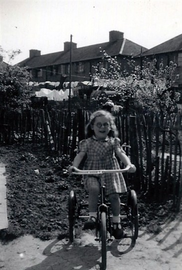 Photo:Taken in the back garden of 86 Tweeddale Road sometime in the late 1940's. Mr & Mrs Taylor lived next door.
