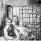 Photo:Rose Prior with her children near the Anderson shelter at Torre walk c.1947