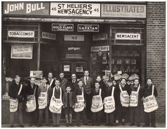 Photo:St. Helier Newsagents and their newspaper boys. 1947