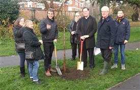 Photo:Cllr Sam Weatherlake and Tom  Brake plant the final tree in the new Wrythe orchard, while members of  the Friends of the Wrythe look on. November 30th 2019