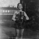 Photo:Ted Thomson senior (b 1924) with Schoolboy Boxing Championship of Gt. Britain Cup c1937